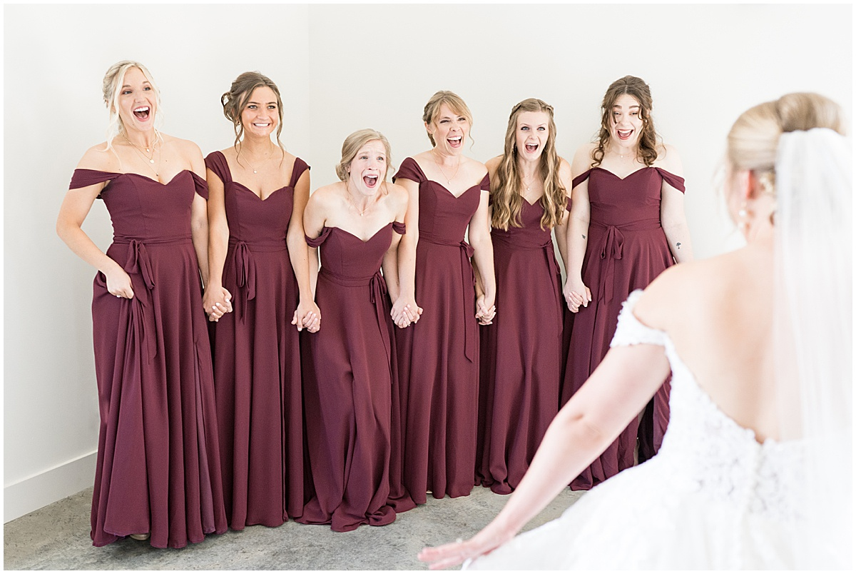 Bridesmaids reaction to bride before wedding reception at New Journey Farms in Lafayette, Indiana
