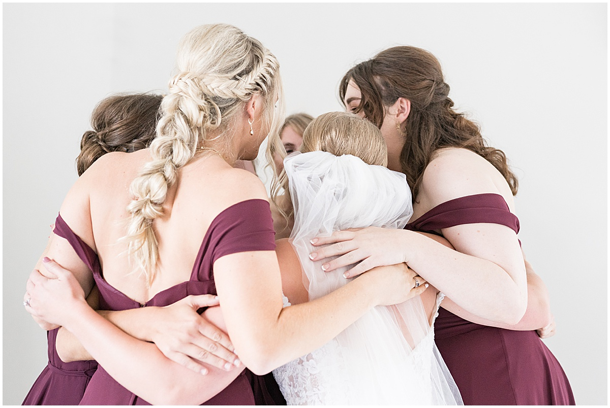 Bridesmaids hug before wedding reception at New Journey Farms in Lafayette, Indiana