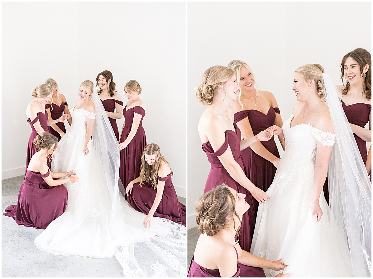 Bridesmaids adore bride before wedding reception at New Journey Farms in Lafayette, Indiana