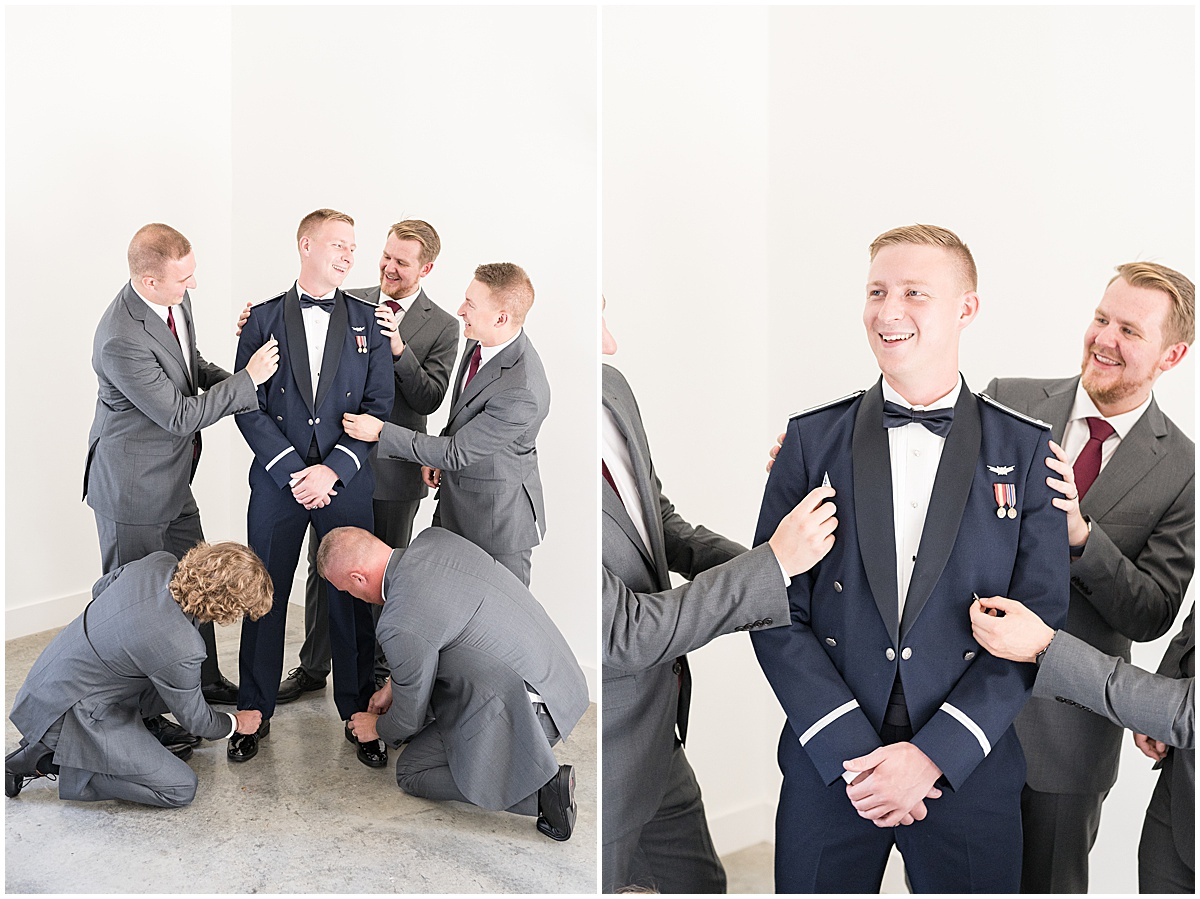 Groomsmen adore groom before wedding reception at New Journey Farms in Lafayette, Indiana